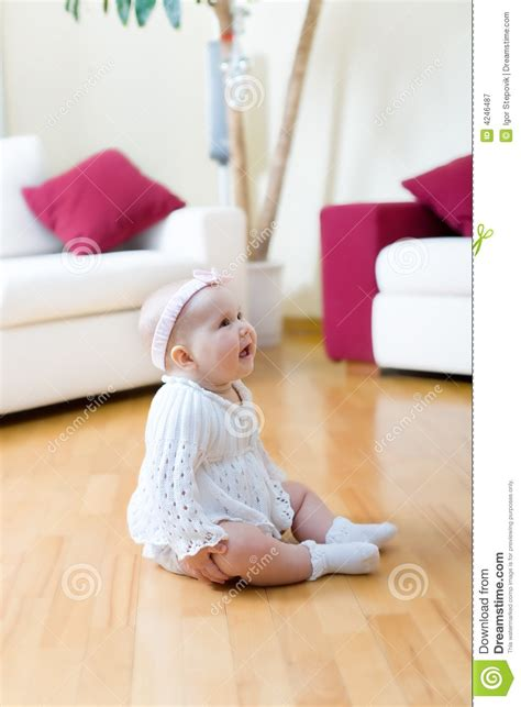 Baby Floor by Baby Seated On A Floor Royalty Free Stock Photography