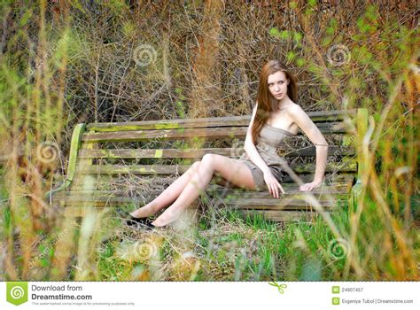 girl bench the girl on the old bench royalty free stock photography