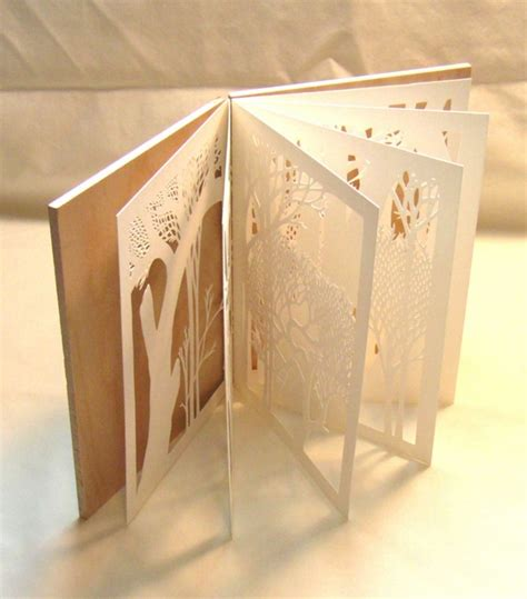 Handmade Artist - tunnel books and cutouts by pistolespress