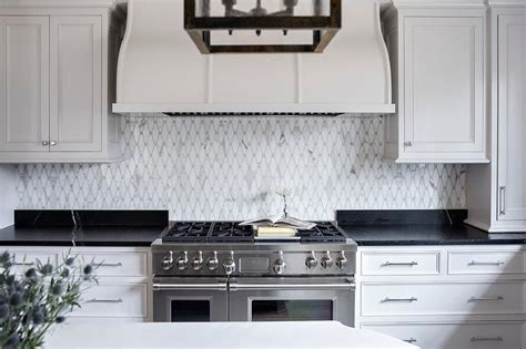Backsplash With Soapstone Counters Chic Kitchen Boasts White Cabinets Paired With