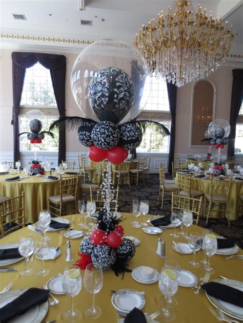 Www elegant balloons com beautiful damask with ostrich feathers and crystals centerpiece