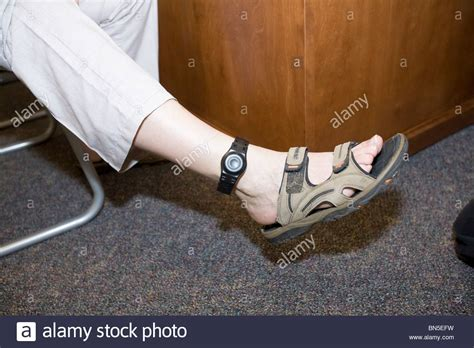 parolee being fitted with ankle bracelet aka electronic