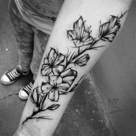 15 Remarkable Black Ink Tattoos Scene360 Black And White Flower Tattoos For On Arm 2