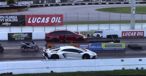 tesla drag 1 4 mile drag race tesla model x p100d vs lamborghini