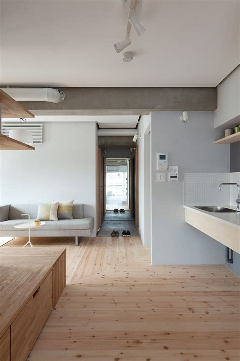 l shaped apartment l shaped wood partition unifies all areas in small practical apartment idesignarch interior