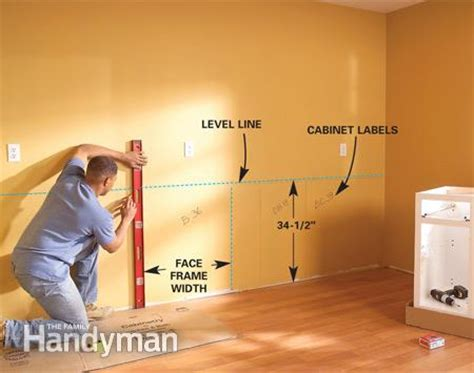 installing kitchen base cabinets installing kitchen cabinets the family handyman