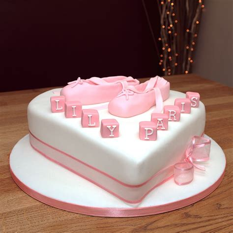 christening cake with handmade fondant ballet shoes