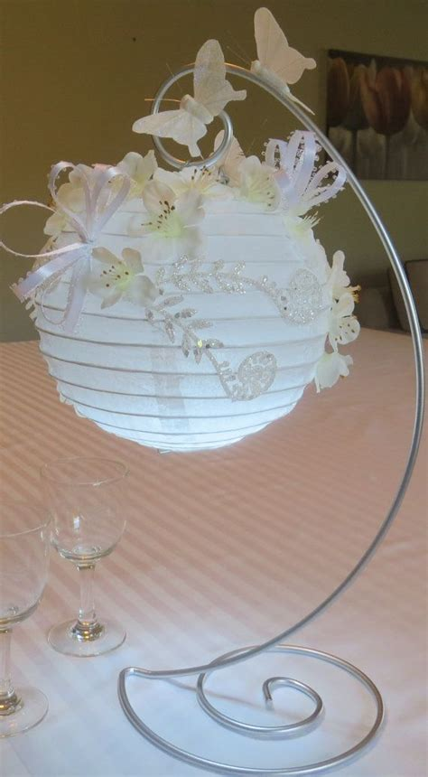 How To Make Paper Lantern Centerpieces - paper lanterns decorated with silk flowers by