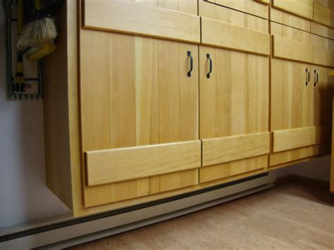 under kitchen cabinet heating board and batten shop cabinets by smallwoodshop