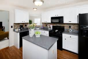 Kitchen With White Cabinets And Black Appliances Kitchen Cabinet Makeover Reveal How To Nest For Less