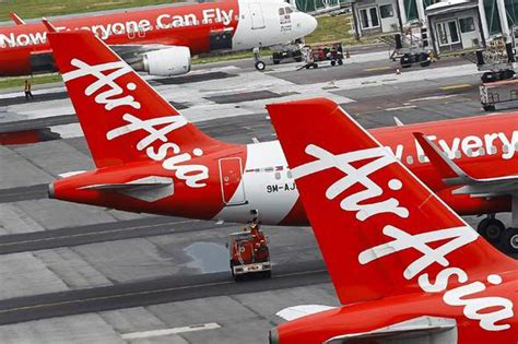 airasia flight qz8501 missing with 162 people on board airasia flight qz8501 missing plane is third tragedy with