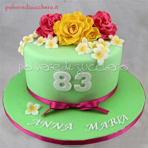 torte fiori pasta di zucchero torta di compleanno con fiori gialle e fucsia in