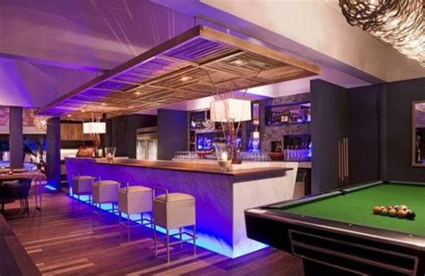 home bar with pool table attempts to recreate a pub