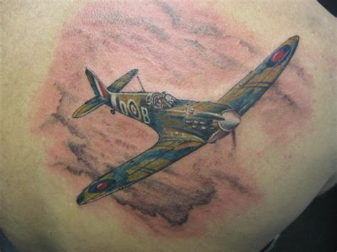 spitfire tattoo flying spitfire on right back shoulder