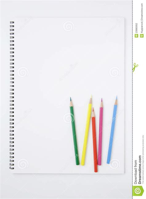 sketchbook and pencils white sketchbook and color pencils stock photography