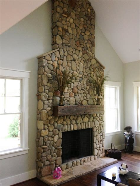a riverstone fireplace sets the tone creative faux panels stunning diy ways to d 233 cor your home with river rocks