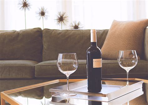 wine on couch 5 sneaky ways to save while still having a social life