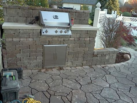 belgard pavers and wall with a napoleon built in grill