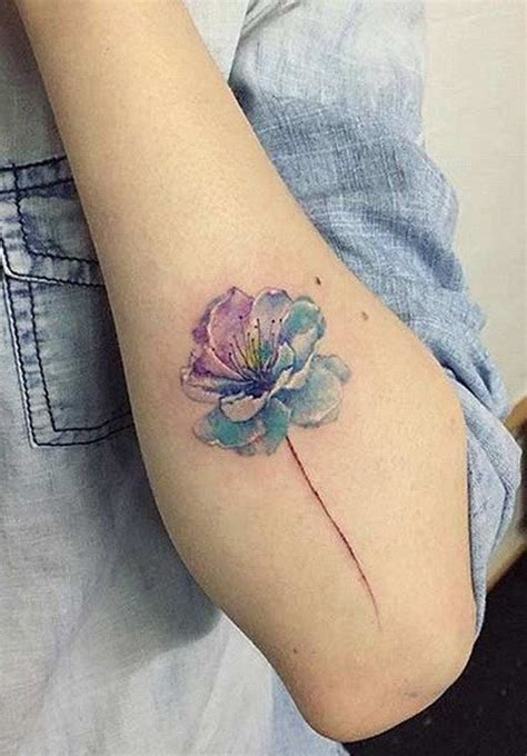 top wrist tattoos image result for tiny watercolor flower ideas