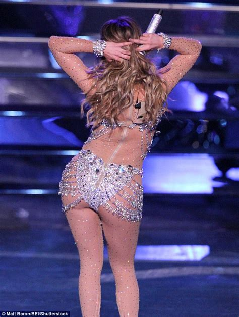 j lo sedere wows in sparkling semi sheer catsuit at all