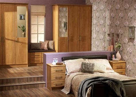 Starplan Fitted Wardrobes by Modern Fitted Wardrobes With A Pippy Oak Finish Shows How A Split Level Modern Bedroom Can Look