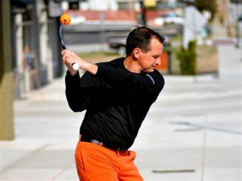 how to swing a golf club correctly orange whip golf trainer review learn how to swing a