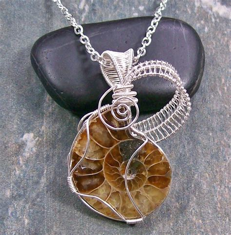 Fossil Spiral Silver ammonite fossil and silver spiral lattice pendant by