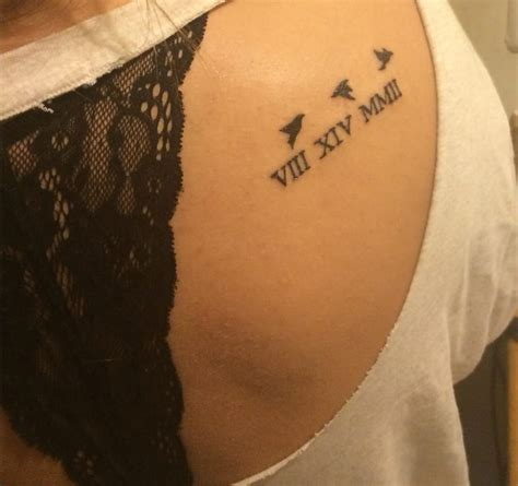 roman numerals birds on my right shoulder blade tattooed