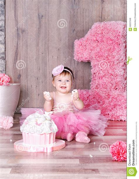 cute themes for baby first birthday cute baby girl eating first birthday cake stock photo