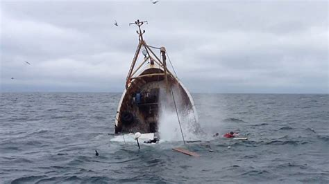 sinking fishing boat videos dramatic sea rescue caught on video as fishermen abandon