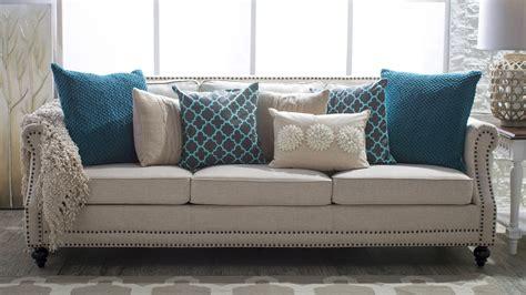 cream pillows for sofa ideas for spicing up a neutral sofa hayneedle com