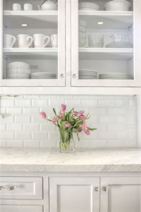 kitchen with white marble beveled subway tile backsplash