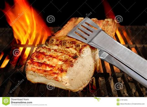 flaming rooster bbq rib loin big chop of pork ribs on the flaming bbq grill stock image cartoondealer 57813205