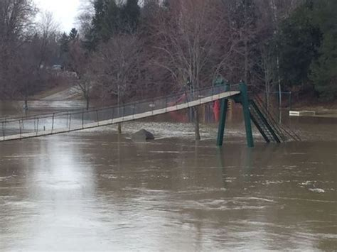 croswell swinging bridge rain high water causes flooding in some areas