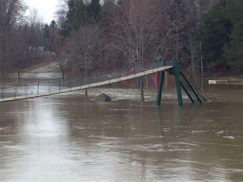 swinging bridge croswell mi rain high water causes flooding in some areas