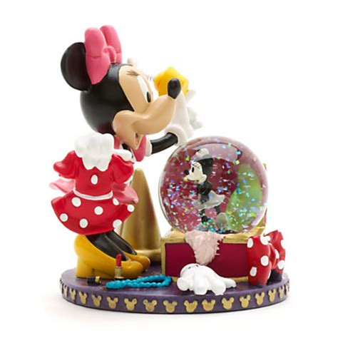 minnie mouse figurine and snow globe snow globes