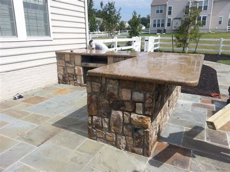 outdoor kitchen with bar and granite countertops leesburg va
