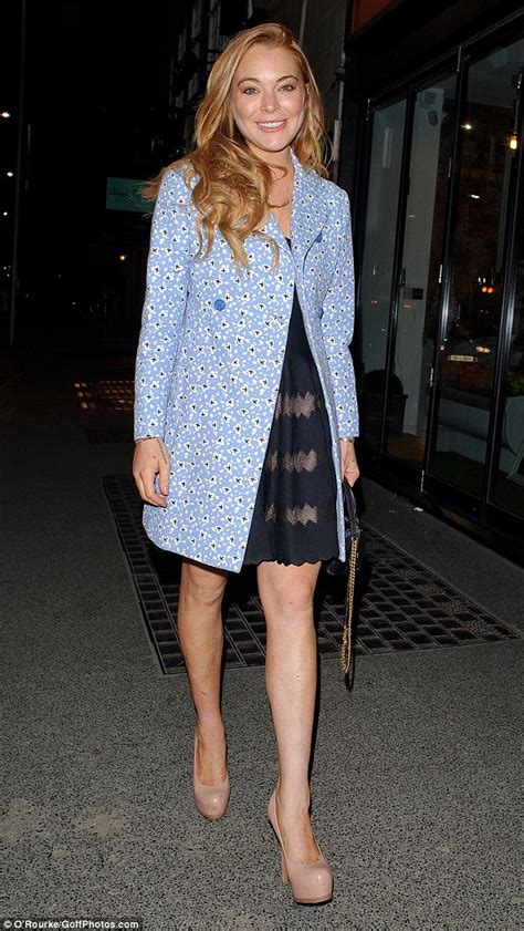 Style Stealer Lindsay Lohans Blue Dress by Lindsay Lohan Embraces S Day Of The Year As