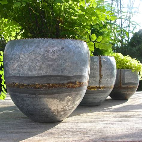 set of three galvanised steel planters by garden