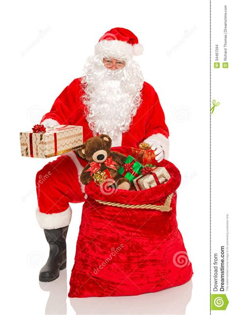 santa handing out gifts isolated stock images image