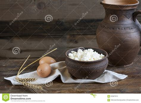Culinary Cottage culinary cottage cheese in a clay bowl on wooden table stock photo image 63587910
