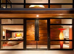 Doors were used on this contemporary residence a matching single door