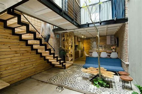 house project small home maximizes space and ventilation using a cool atrium