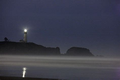 light house at night yaquina lighthouse at night photograph by larry robinson