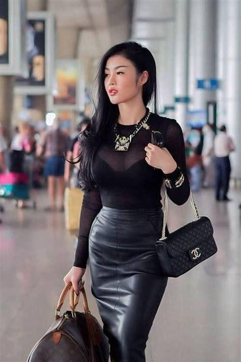in sheer blouse black bra and tight black