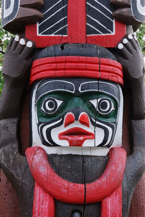 carving face   totem pole stock  image