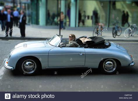 vintage porsche convertible driving porsche convertible sports car stock