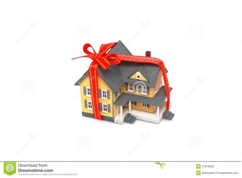house gift gift miniature house with red ribbon isolated stock photos