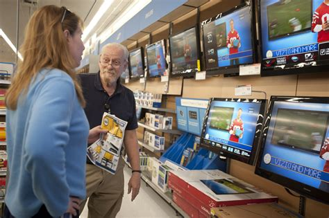 a walmart associate helps a customer