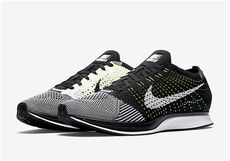 Adidas Flyknit Racer the nike flyknit racer in black white and volt has a